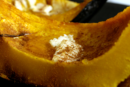 Roasted Acorn Squash wedge with butter, maple syrup, and cinnamon