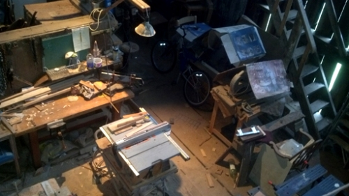 In his barn/workshop looking down from the loft.